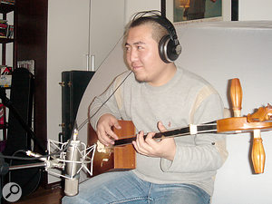 Hanggai's band leader Ilich, playing the two-string banjo that is at the heart of their sound.