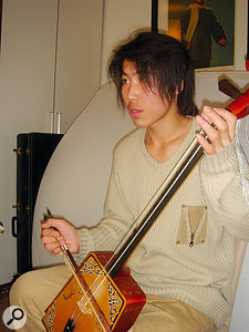 The other central instruments in Hanggai's music are horsehair fiddles such as the matouqin and the yekul, played here by Bagen.