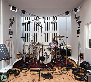 Rik Simpson has numerous microphones permanently rigged and ready to record. Among the more unusual mics visible in this shot of Will Champion's drum kit are a  vintage STC 4012 'ball and biscuit' dynamic mic, between the two overheads, and a  Royer stereo ribbon mic as an M–S array in front of the kit.