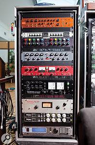Much of Rik Simpson's gear from The Beehive was transported repeatedly across the Atlantic during the album sessions, hence the robust flightcases! The left rack, from top, contains the Vertigo Sound VSM2, SSL bus compressor and GML 8200 EQ, which were used across the master bus for the final mix, plus a Retro Instruments 2A3 equaliser, Thermionic Culture Vulture distortion box and Phoenix compressor, Teletronix LA2A compressor, Empirical Labs Distressor compressors (x2) and Eventide H8000FW multi–effects unit.
