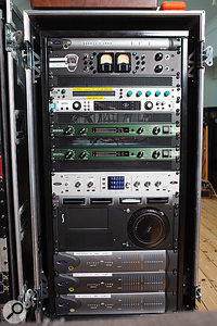 The right rack contains, from top: Avid HD MADI interface, Shadow Hills Oculus, Crane Song HEDD 192, UA Apollo Quad, Burl B2 Bomber A–D and D–A converters, Antelope Isochrone clock, rackmounted Apple Mac Pro computer and Avid HD I/O interfaces (x3).
