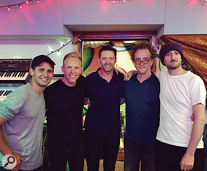 Team photo: from left, composers Benj Pasek and Justin Paul, actor Hugh Jackman, Greg Wells, and director Michael Gracey.