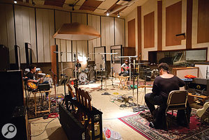 Mills and Everett recorded Alabama Shakes as a  band in one room, with isolation booths used only for the bass amp. This shot shows the later sessions at Ocean Way Studio B. Left to right: Heath Fogg (guitar), Steve Johnson (drums), Zac Cockrell (bass) and Brittany Howard (guitar and vocals).