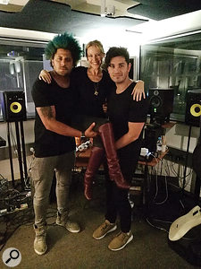 She ain't heavy, she's Kylie Minogue: Sky Adams (left) and songwriter Danny Shah give the artist alift.