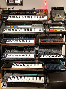 This rack of classic keyboards and drum machines includes (from top, left to right): Roland Juno 60 and Korg Minipops; Roland JX-8P and TR-808; Korg MonoPoly and Linn LM2; Moog Voyager and Korg MS20; Solina String Ensemble and Oberheim DMX; and the immortal Yamaha DX7.