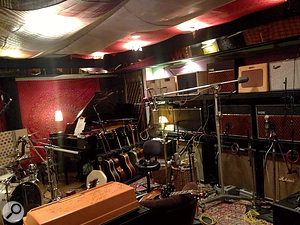John Shanks's room at Henson is stuffed to the gills with guitars and other instruments. Note the wall of amplifiers to the right!