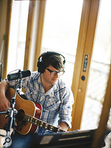 Scenes from abarn: Decemberists frontman Colin Meloy lays down avocal and acoustic guitar take, with aShure SM7 for the former and a Wunder CM7 for the guitar.