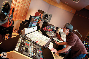 Though he has relocated to the LA headquarters of his own Mirrorball Entertainment, Tony Maserati maintains the same hybrid analogue/digital setup that he has used for many years. The gear rack in the foreground includes many favourite outboard dynamics processors: Alan Smart C2, Universal Audio 1176, Chandler EMI TG Limiter, Neve 33609, 2x Urei LA3A and Chandler Zener Limiter. Behind that is Maserati's Avid D-Command control surface, and behind that are visible his Neve Melbourne and Chandler Mini Mixer analogue mixers.