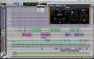 The Pro Tools Session for 'Getting Ready For Christmas Day'. The 10 topmost tracks are for Jim Oblon's muffled drum kit. Immediately beneath them, in green, is the sample of the sermon that inspired the song, and below that, Paul Simon's lead vocal. Apart from that, the main contributions are a tremoloed acoustic guitar (light green) and an electric guitar, miked both at the amp and the strings.
