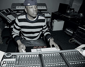 Dot Da Genius at work in his Head Banga studio, where 'Day 'n Nite' was made. His main instruments are visible in the background: Roland MV8000 sequencer/sampler and Yamaha Motif ES7 keyboard.