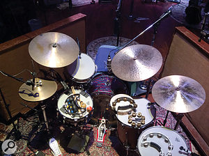 Visible in this shot of Ian Fitchuk's drum kit are the SM57 and AKG C451 taped together on the snare, Josephson E22 tom mics, Neumann U47 directly above the kick drum and a  Neumann KM84 on hi–hat.