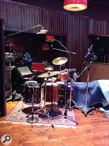 Another perspective on the drum miking, with a  single Neumann U67 used as a  relatively distant overhead, and AKG C451s closer to the cymbals.
