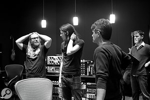 Drummer Ian Fitchuk (left) and bassist Eli Beaird (right) discuss arrangements with James Bay and Jacquire King.