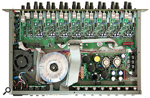 A view of the preamp internals. The fan and toroidal transformer are in the bottom left-hand corner, while the chunky, multi-voltage, regulated power supply is on the right at the back.