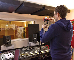 Neil sets up the vocal mics in front of the monitor speakers in his control room at Half Ton studios in Cambridge.