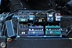 If your bassist is using a  lot of pedals, it's important to take your DI feed after the last pedal in the chain. You should also check that pedal's settings to avoid any sudden jumps in level when one of them is activated.