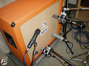 This Orange 4x12 cab has been miked on each cone with a different microphone. Clockwise from left: Beyer MC740, Sennheiser MD441, Electrovoice RE20, and Beyer M160.