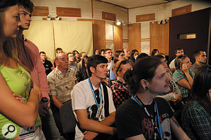 An audience of AES student delegates look on as the mixing process begins...