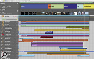 A typical Logic project from March Of The Dinosaurs. Note the use of the marker track at the top to pick out different thematic sections. Each of the tracks visible below the video track is afolder track, containing all the MIDI parts related to aparticular sample library.