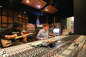 Tom Fletcher (left) goes for a guitar take, with a  watchful Jason Perry at the controls.