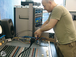 Getting hands on: in these software-dominated times it's easy to forget the convenience and immediacy offered by a good old-fashioned desk, patchbay and outboard gear.