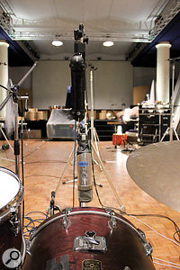 This view from the drum stool shows the Neumann U47 FET used to mic the outside of the kick drum and the AEA stereo ribbon mic placed in front of the kit.