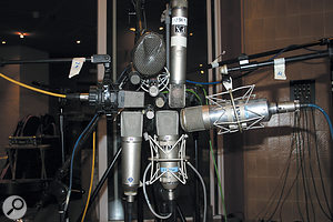 If mics have the same polar pattern and are placed at the same distance from the source, they'll pick up the same balance of direct and reflected sound, no matter whether they are dynamic or capacitor designs.