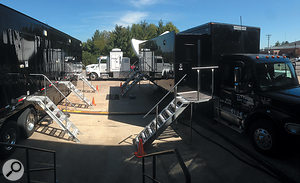 Incorporating the live segments into the pre-recorded show required no fewer than three remote trucks. On the left of this shot is Aspiration, which is being fed with the audio mixes from Vibration (right) via MADI cables running under the step-guard. To the rear is the Uplink truck with large satellite dish!