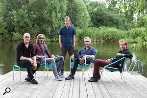 The National pose in front of the pond that gives Aaron Dessner's studio its name. Left to right: bassist Scott Devendorf, drummer Bryan Devendorf, guitarist/keyboard player Bryce Dessner, singer Matt Berninger and guitarist/producer Aaron Dessner.