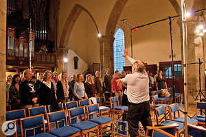 The aim of the recording as a whole was to present an authentic performance of the St John Passion in its liturgical context. The ancillary material required a larger chorus to act as a congregation.