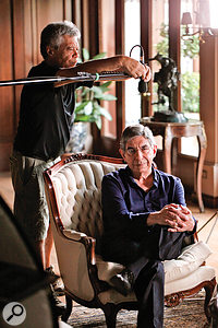 The boom allows the interviewee mic to be positioned fairly close and above the subject (in this case, Oscar Arias), yet out of camera shot.