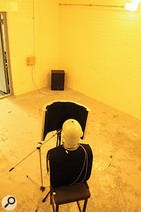 The ability of the 'portable vocal booths' to screen external noise was tested in the small reverberation chamber at Salford. A  loudspeaker in the corner emitted white noise, and a  B&K 'head and torso simulator' was used to mimic the presence of a  singer.