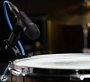 The four ST‑4 dynamic mics each come with their own rim mount.