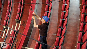 Simon Hancock checks one of the suspended KM140 choir mics.