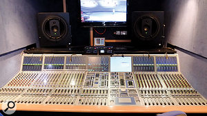 The Radio 3 Stagetec Aurus digital console. A sliding score shelf covers two control sections on the left side of the desk. Geithain RL901K monitors peer over the console.