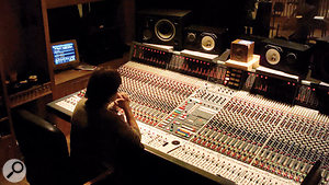 As you can see from this photo of Feist mix engineer Renaud Letang seated at a Neve mixing desk, 'grot boxes' — Yamaha NS10s and an Auratone speaker in this case — have a prominent place in serious studios.