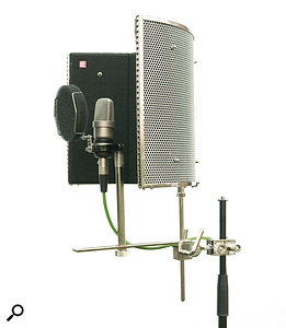 As a vocal mic is so sensitive in the direction of the singer, it will pick up reflections from any walls or surfaces behind and to the sides of the singer, so whether you decide to use a reflection filter or not, acoustic treatment in these areas is a priority. A Reflexion Filter or similar device is designed to absorb some of the sound that would hit the rear of the mic, so if you're thinking of buying one, it makes sense to use it in conjunction with acoustic treatment to the rear of the performer, rather than simply using one or the other.