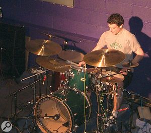 Miking up a drum kit on stage isn't always necessary or possible in small venues. However, if the size of the room and the PA system can handle it, even a single mic on the kick drum can really contribute to the live mix.