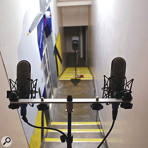 A spaced pair of omnidirectional microphones recording an impulse response in a large, narrow stairwell. An active speaker is used to emit the test tone from a lower position. The response was recorded at different distances and with the microphone and speaker positions switched around.