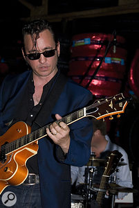 Richard Hawley playing one of his beloved Gretsch guitars on stage.
