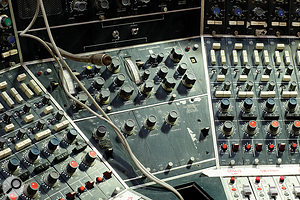 Close-up on the Neve desk showing the compressor/limiters and talkback section.
