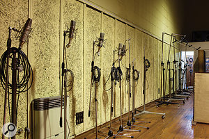 Most of the impressive collection of mics are stored on their stands, lined up against the walls of the live room.