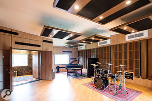 The main live area houses the studio's Yamaha grand piano, with plenty of space available for other instruments too!