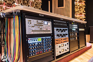 The outboard collection includes audio processors and synthesizers such as these Korg Radias and Moog Voyager rackmount units.