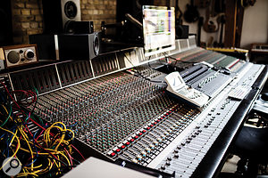 The mixing setup is centred around a 56-channel SSL 9000 J-series console.