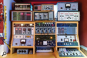 Not your average outboard rack! This panel in the control room is home to, among other things, no fewer than six Pye limiters (lower left and top right), BBC mic amp modules and 'limiting amplifier' (centre) and a  Cinema Engineering 4031B equaliser (centre right).