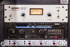 A custom-built LA-2A-type limiter by Ovietronix and a Demeter preamp — one of only two units that could be salvaged from a studio fire.