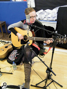 Anja Baum alternated between playing percussion and acoustic guitar and, unfortunately, her guitar did not have a pickup in it. Since she has a very powerful voice and plays very quietly, this meant that most of her guitar parts had to be overdubbed.