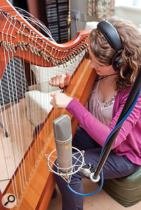 Miking the harp with asingle capacitor microphone, positioned two feet back from the centre of the strings.