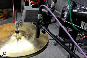 Unusually, Matt opted to use two separate mics on the hi-hat, as they offered different 'flavours'. One, a Neumann KM184i sounded a litle brighter, and the other, the M201 that had been retired from snare duties, was a little less brash-sounding.